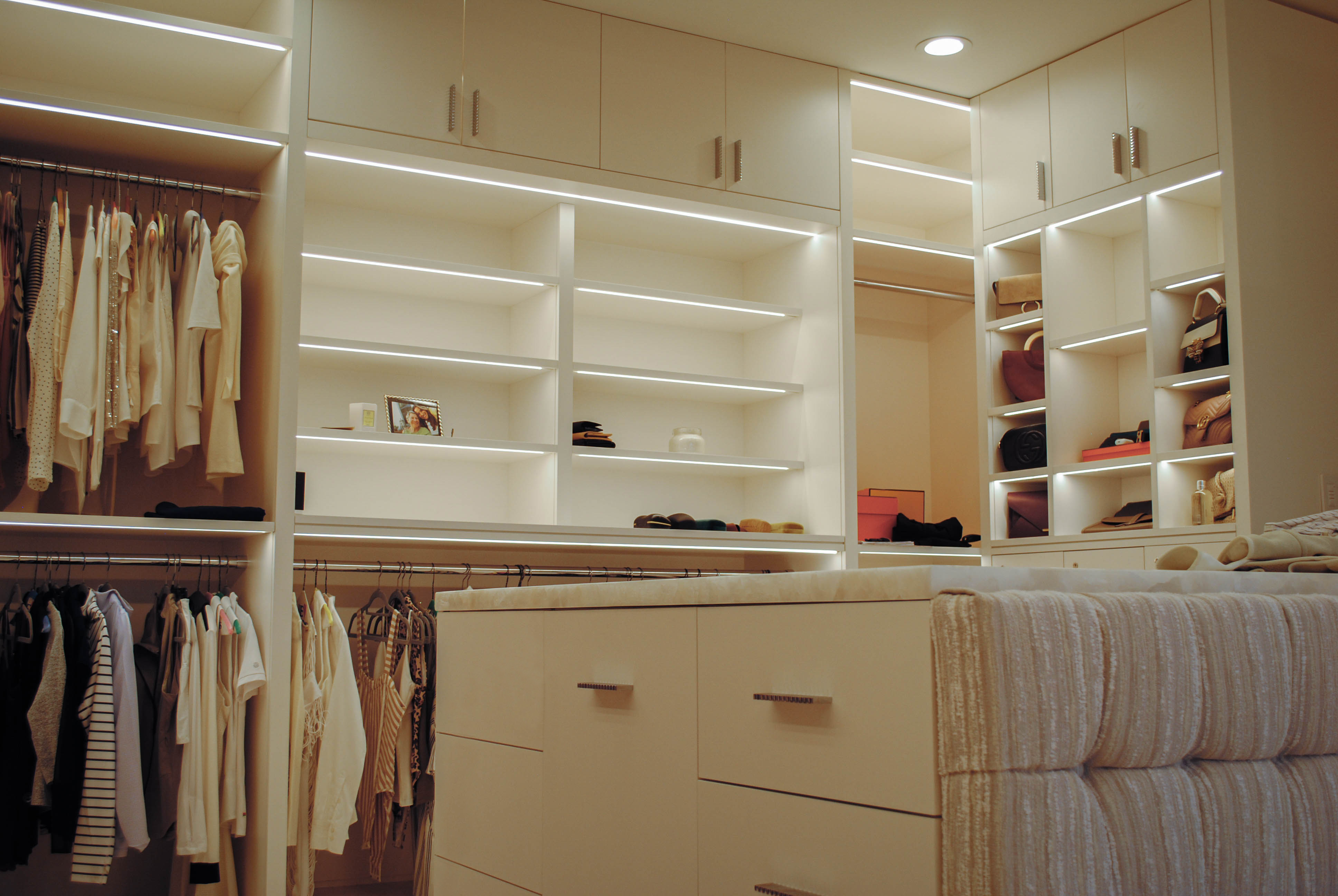 Walk In Closet featuring custom millwork